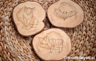 Origami auf Holzscheiben